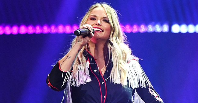 Check Out Miranda Lambert Posing in This Stunning Fringe Denim Jacket with a White Short Dress