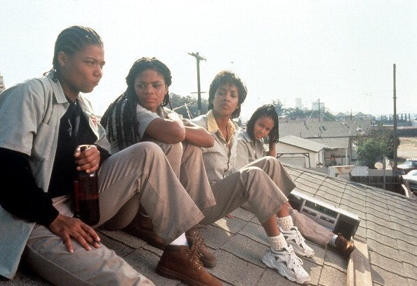 Queen Latifah, Kimberly Elise, Vivica Fox and Jada Pinkett all sitting on the roof of a house on 'Set It Off' | Photo: Getty Images