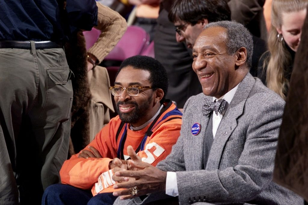 Spike Lee and Bill Cosby smile on while sitting next to each other as they the New York Knicks play the Philadelphia 76ers at Madison Square Garden | Source: Corey Sipkin/NY Daily News Archive via Getty Images