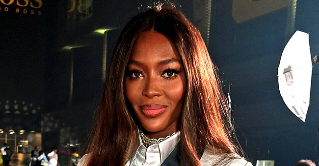 Naomi Campbell Flaunts Flawless Skin and Toned Abs in Midriff-Baring Yellow Top in Photo