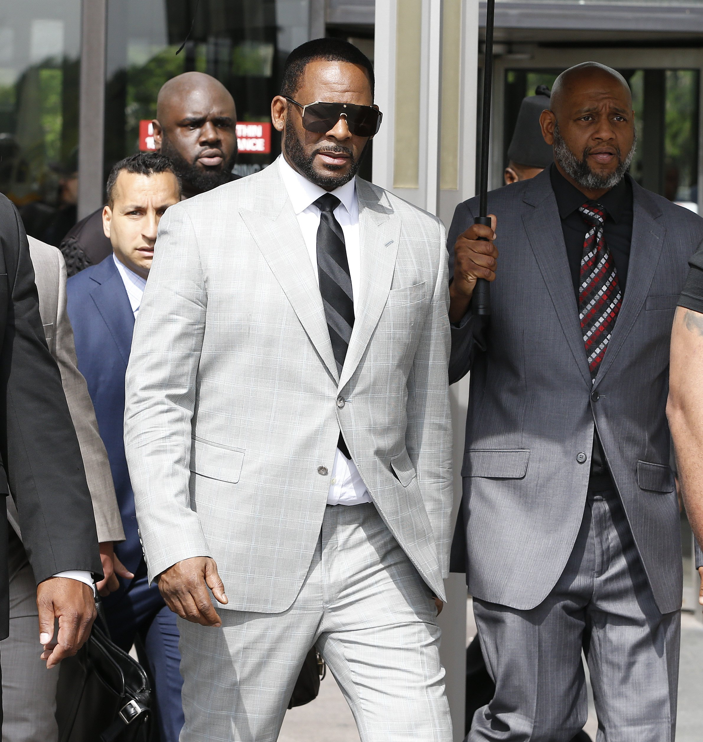 R. Kelly appearing in court as he faced new criminal sexual abuse charges in June 2019.   Photo: Getty Images