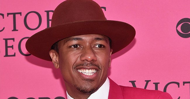 Nick Cannon's Son Golden Smiles at His Baby Sister Wearing a Cute Outfit & Matching Bow (Photo)