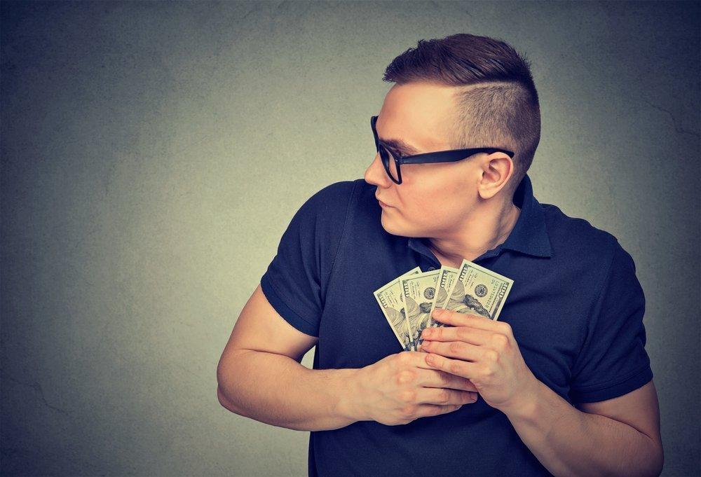 Selfish Man grabbing Money | Photo: Shutterstock