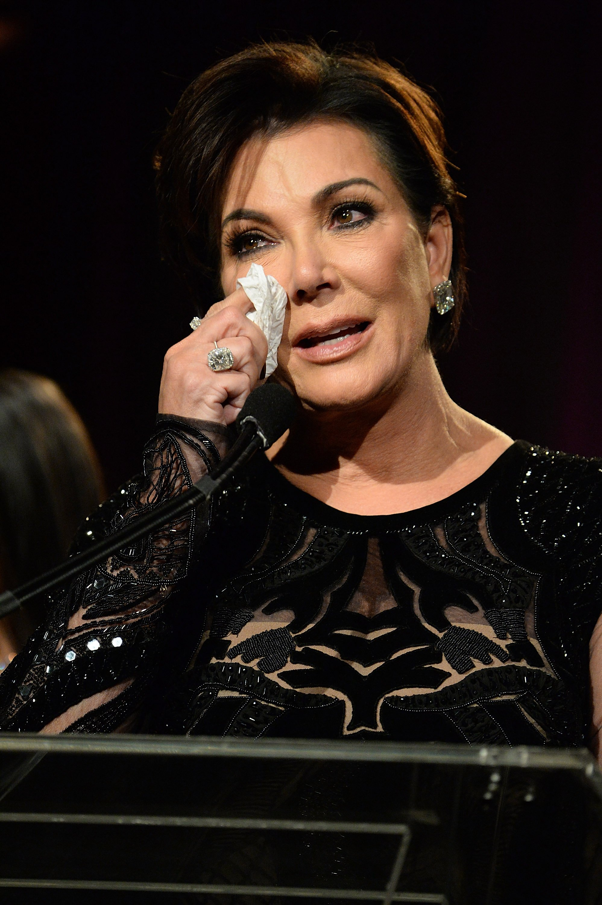 Kris Jenner wiping off tears as she speaks onstage during the 2016 Angel Ball. | Photo: Getty Images