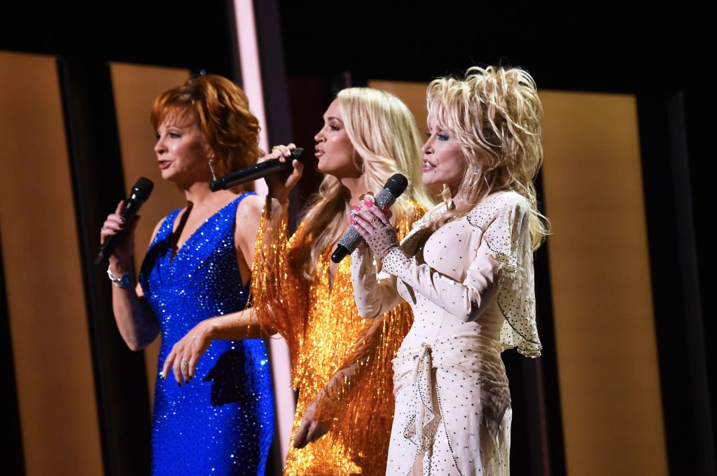 Dolly Parton, Carrie Underwood, Reba McEntire. Image Credit: Getty Images