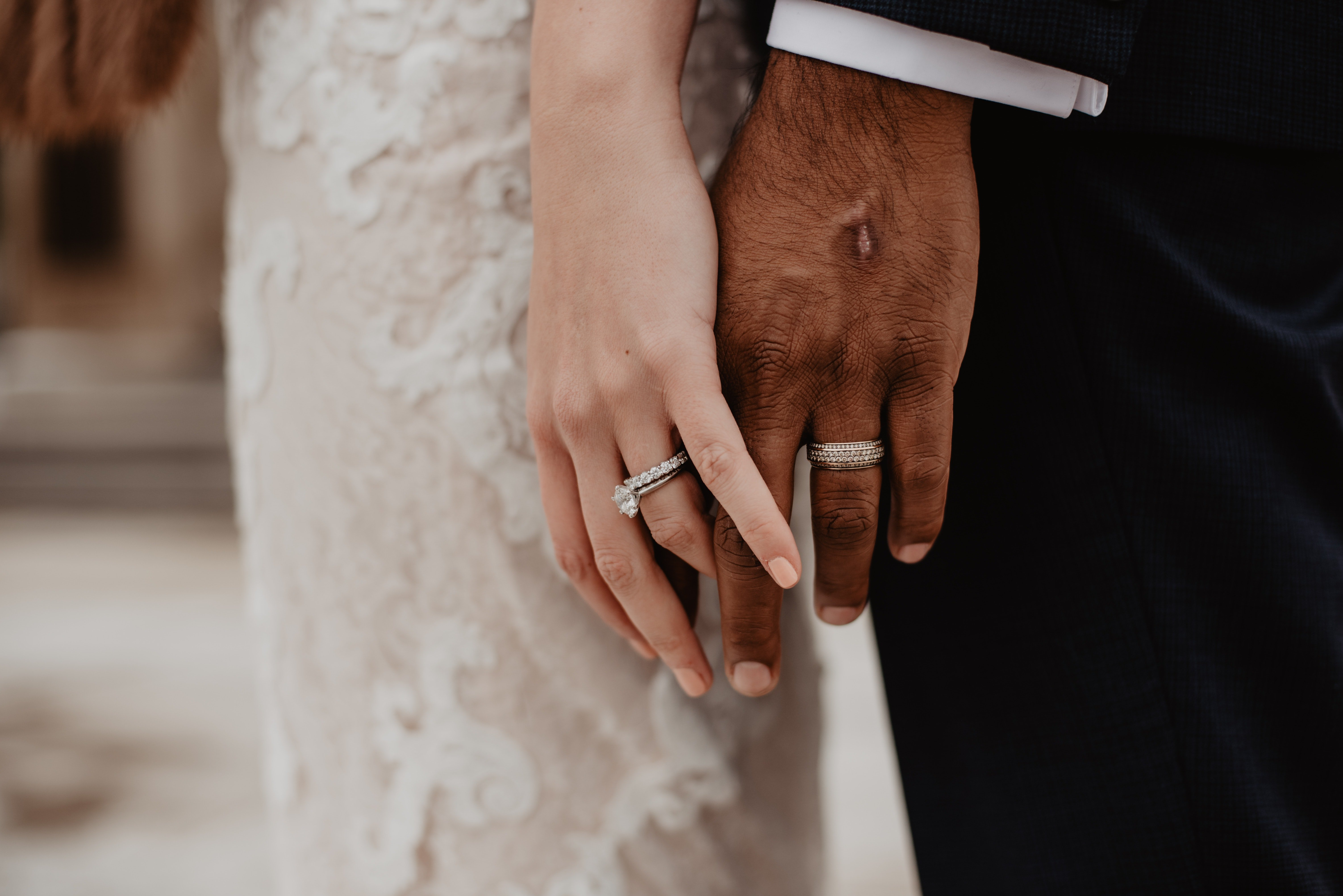 A newly wed couple holding hands.   Pexels/ Emma Bauso
