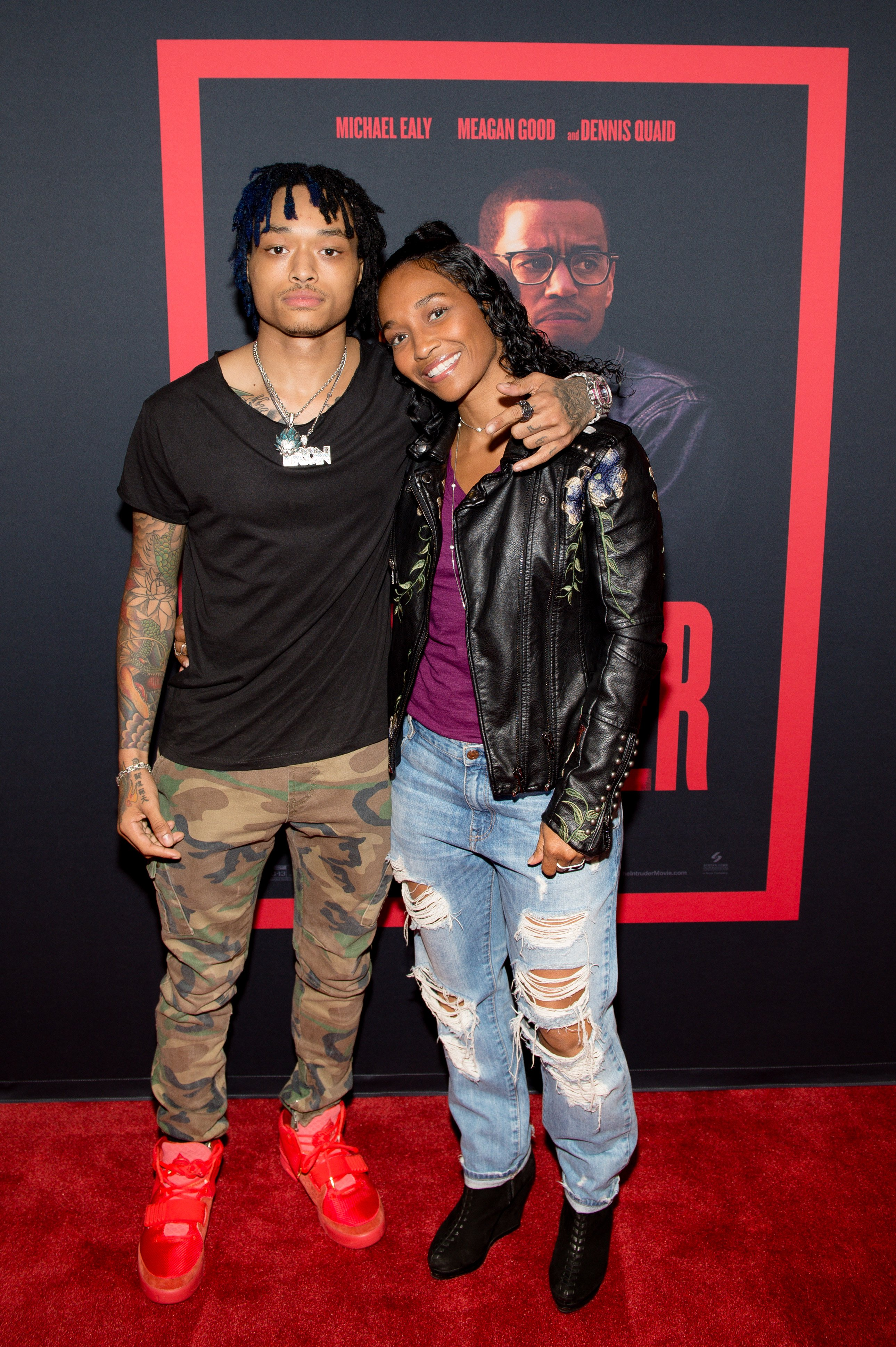 """Rozonda 'Chilli' Thomas and son Tron Austin posing at the red carpet of """"The Intruder"""" screening on April 22, 2019.   Photo: Getty Images"""
