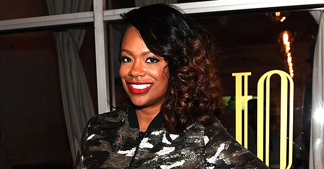 RHOA Star Kandi Burruss Stuns with Her Cleavage on Display in a Plunging Yellow Dress (Photos)
