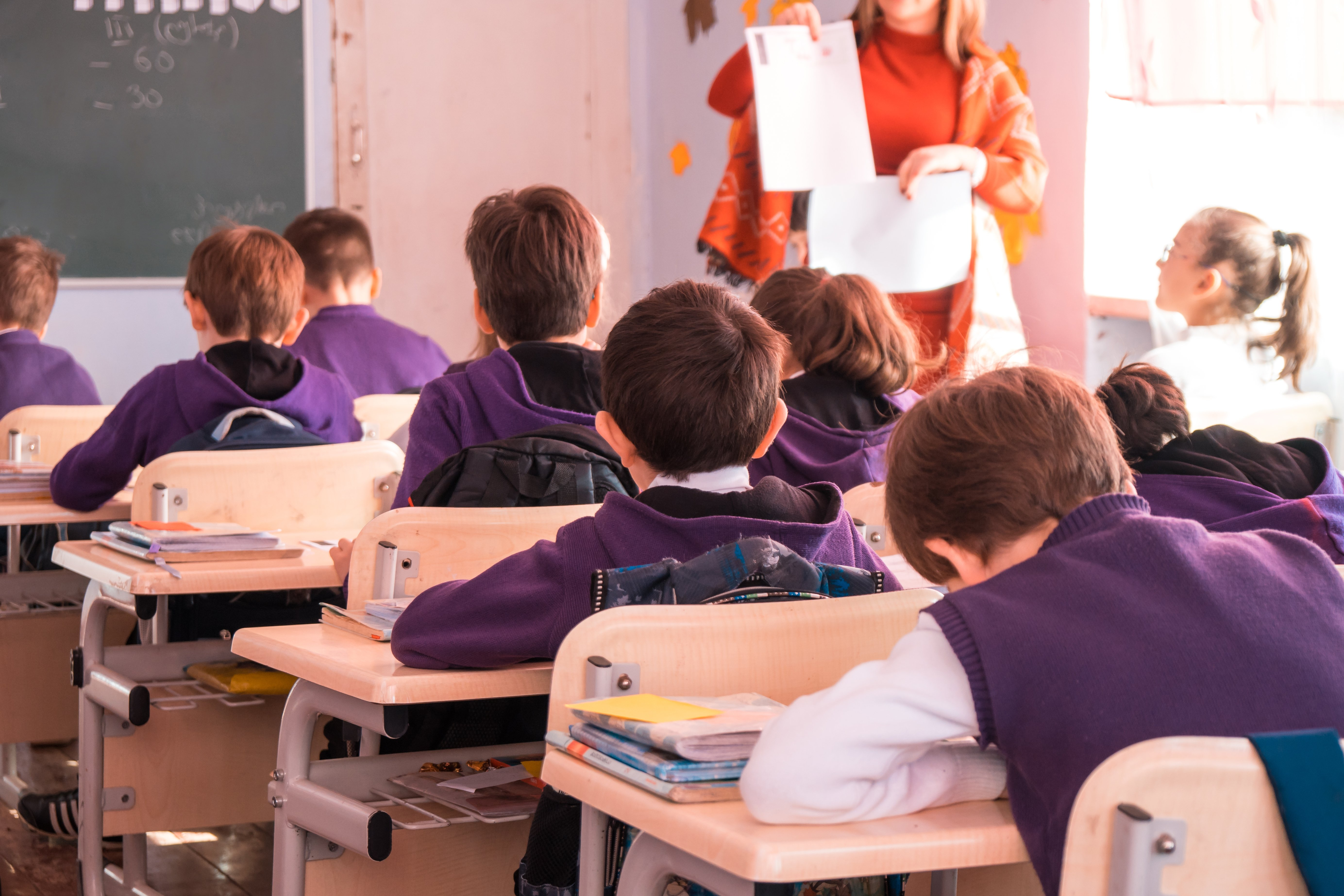 School children participating actively in class | Shutterstock.com