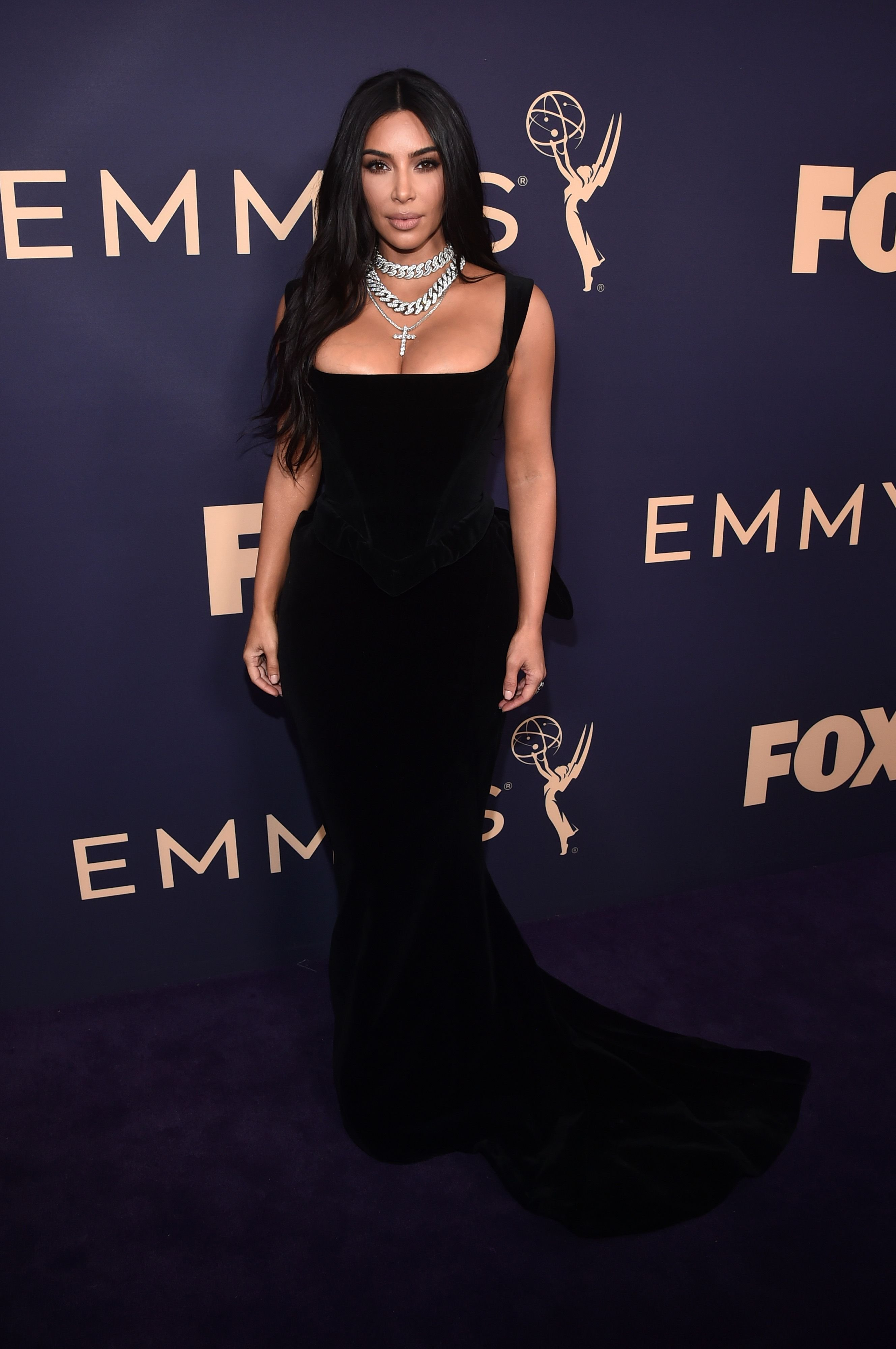Kardashian wearing a gorgeous black dress at the Emmys Awards in 2019.   Photo: Getty Images