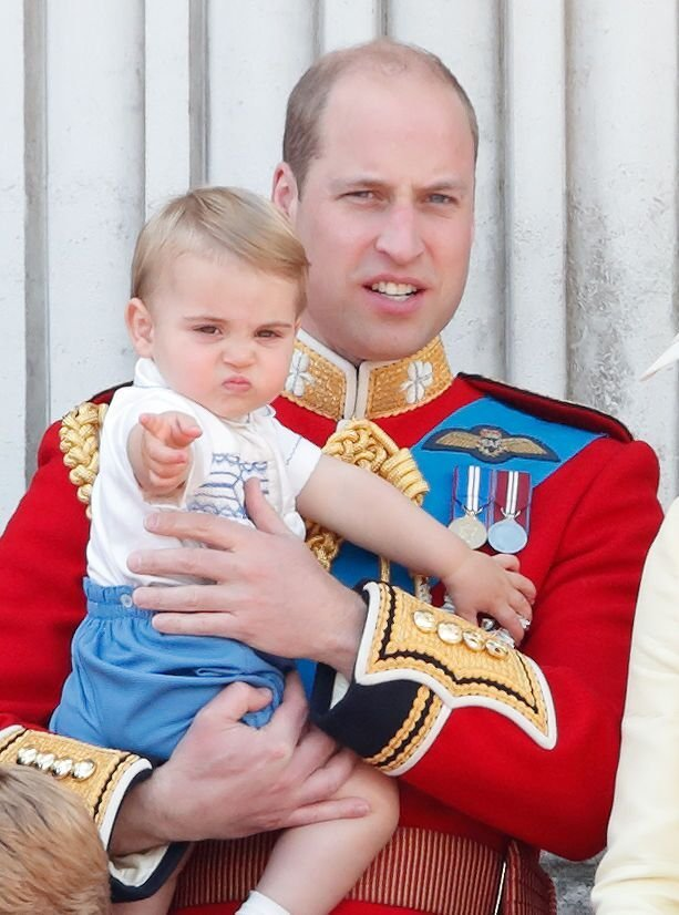Prince William carries Prince Louis on the balcony of Buckingham Palace during Trooping The Colour. | Source: Getty Images