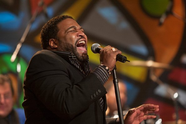 Gerald Levert performs with band The Funk Brothers | Photo: Getty Images