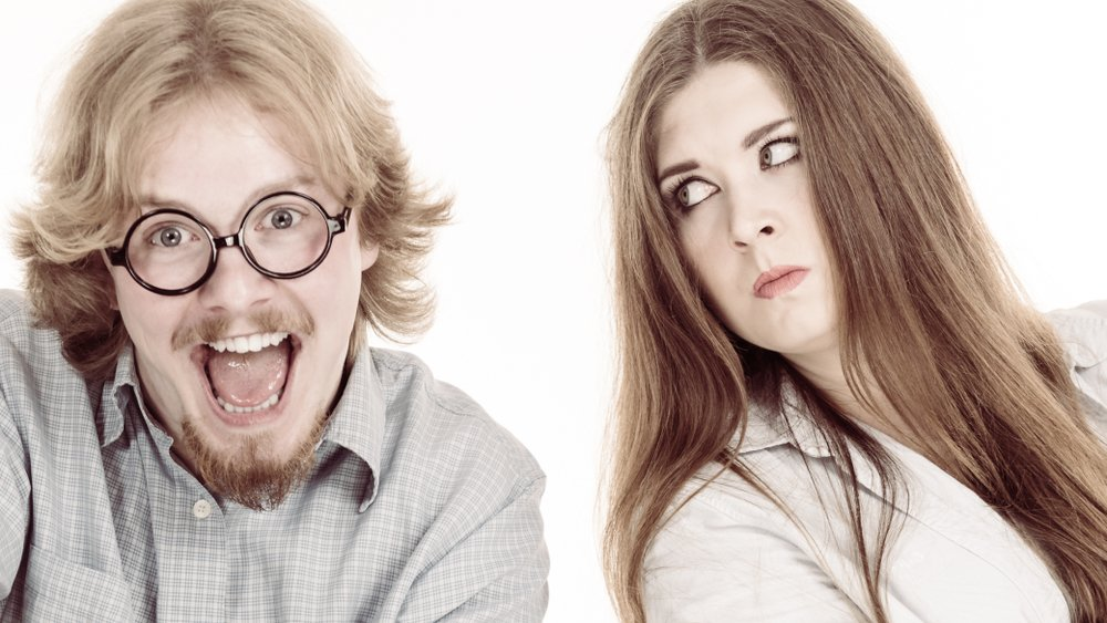 A photo of a man laughing and a lady with a straight face | Photo: Shutterstock