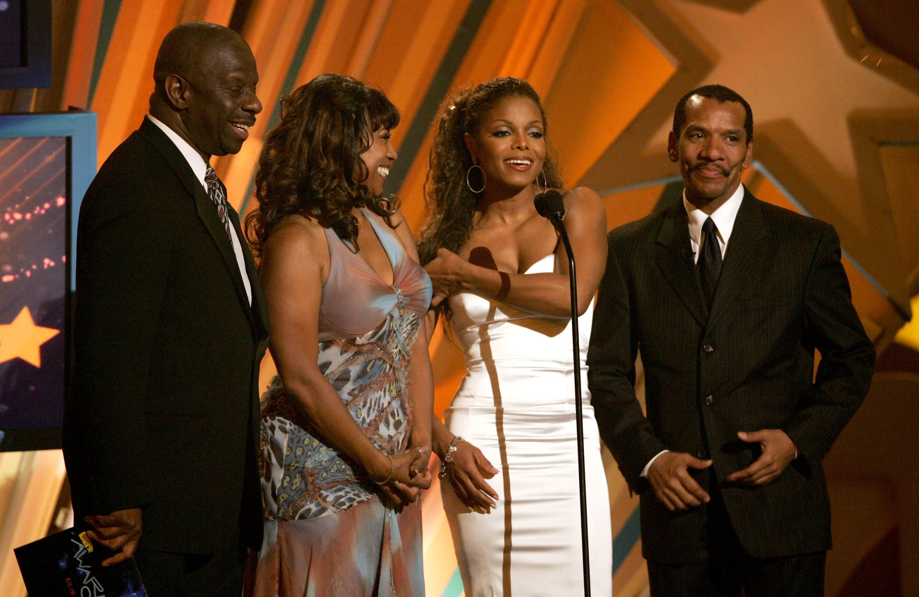 Jimmie Walker, BernNadette Stanis, singer Janet Jackson and actor Ralph Carter present an award onstage at the 2006 BET Awards on June 27, 2006 in Los Angeles, California. | Source: Getty Images