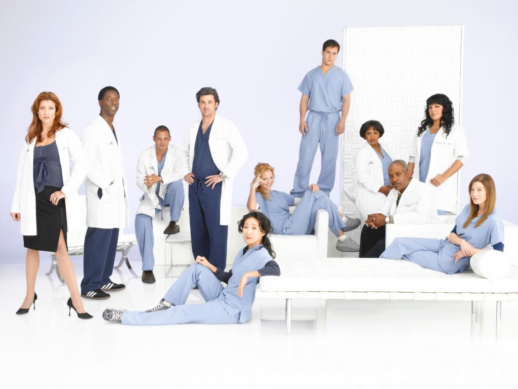 "Kate Walsh, Isaiah Washington, Justin Chambers, Patrick Dempsey, Sandra Oh, Katherine Heigl, T.R. Knight, Chandra Wilson, James Pickens, Jr., Sara Ramirez and Ellen Pompeo in a promotional picture for ""Grey's Anatomy"" on August 15 2006 