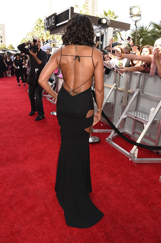 Actress Taraji P. Henson flaunting some of her tattoos at the 2015 Billboard Music Awards at MGM Grand Garden Arena on May 17, 2015. | Photo: Getty Images