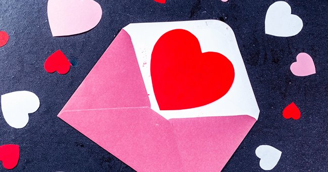 Daily Joke: Balding Man Places 'Love' Stamps on Pink Envelopes at the Post Office