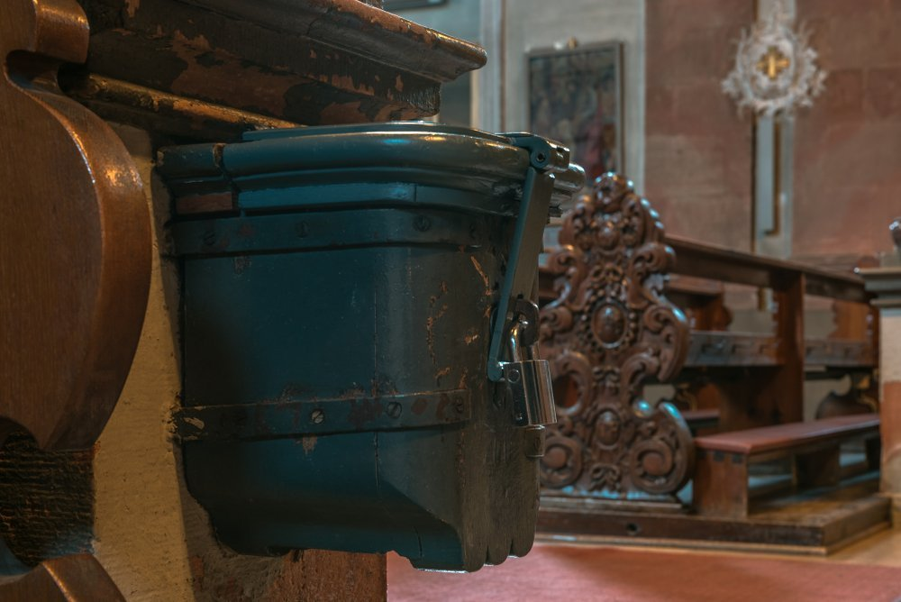 Closed donation box for donations in a church | Getty Images