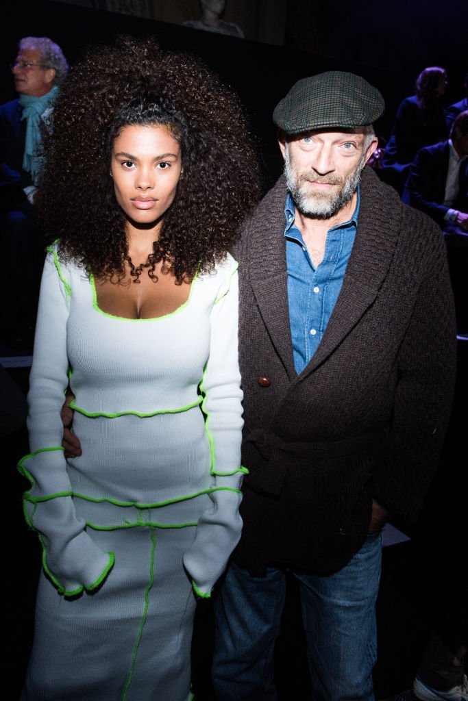 Tina Kunakey et Vincent Cassel au défilé ETAM en 2018. l Source : Getty Images