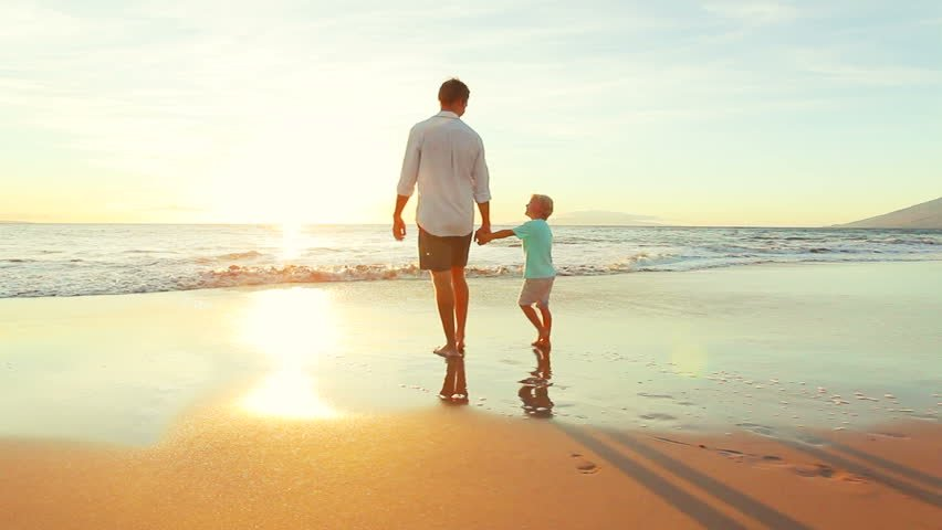 A father walking with his son | Photo: Shutterstock