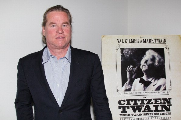 Veteran actor Val Kilmer posed beside a poster of his 2012 show in California. | Photo: Getty Images
