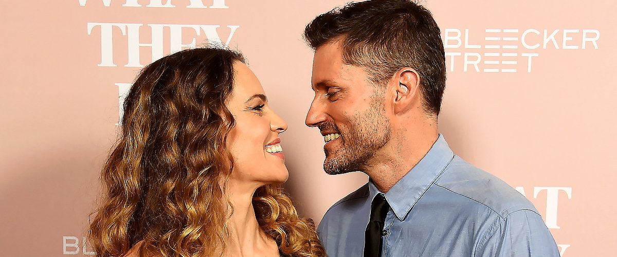"""Hilary Swank and husband Philip Schneider arrive at the Los Angeles Special Screening Of """"What They Had"""" at iPic Westwood on October 9, 2018 