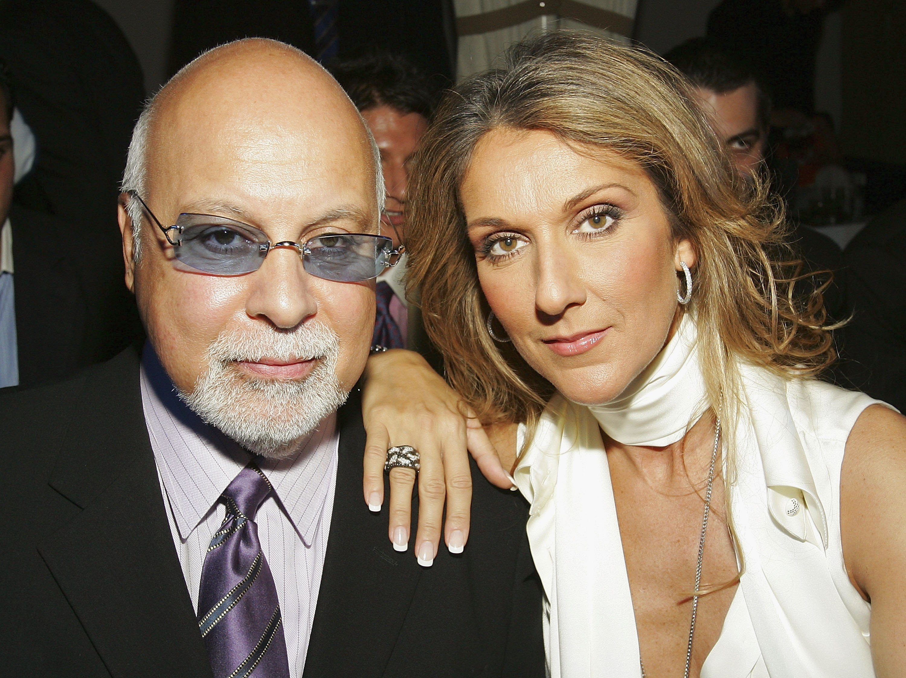 Singer Celine Dion (R) and her husband and her late-husband Rene Angelil pictured before a fashion show by jewelry designer Chris Aire, 2006 Las Vegas, Nevada.   Photo: Getty Images