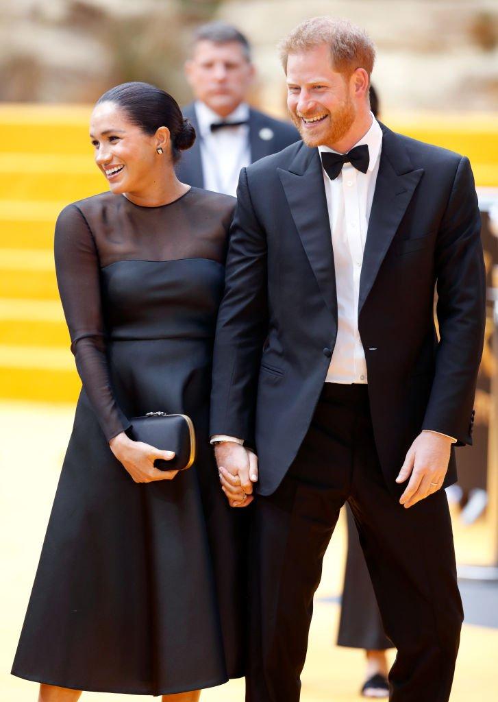 """Meghan Markle et le Prince Harry à la première du """"Roi Lion"""" le 14 juillet 2019. l Source : Getty Images"""
