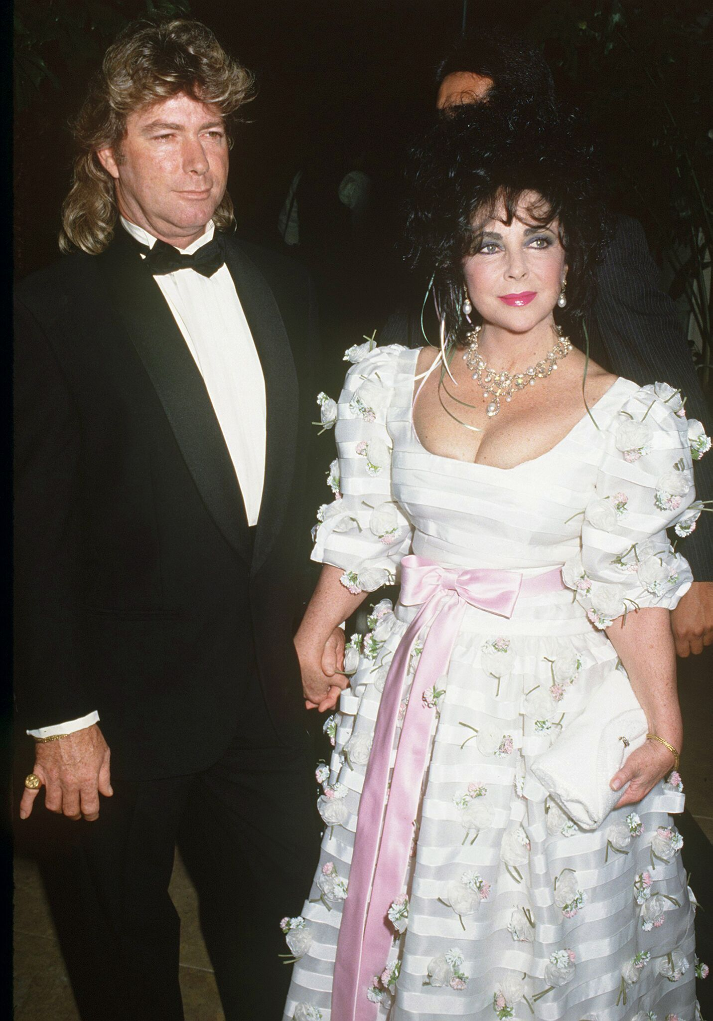 Elizabeth Taylor (1932 - 2011) and her husband Larry Fortensky attending the Carousel of Hope at the Beverly Hilton Hotel | Getty Images
