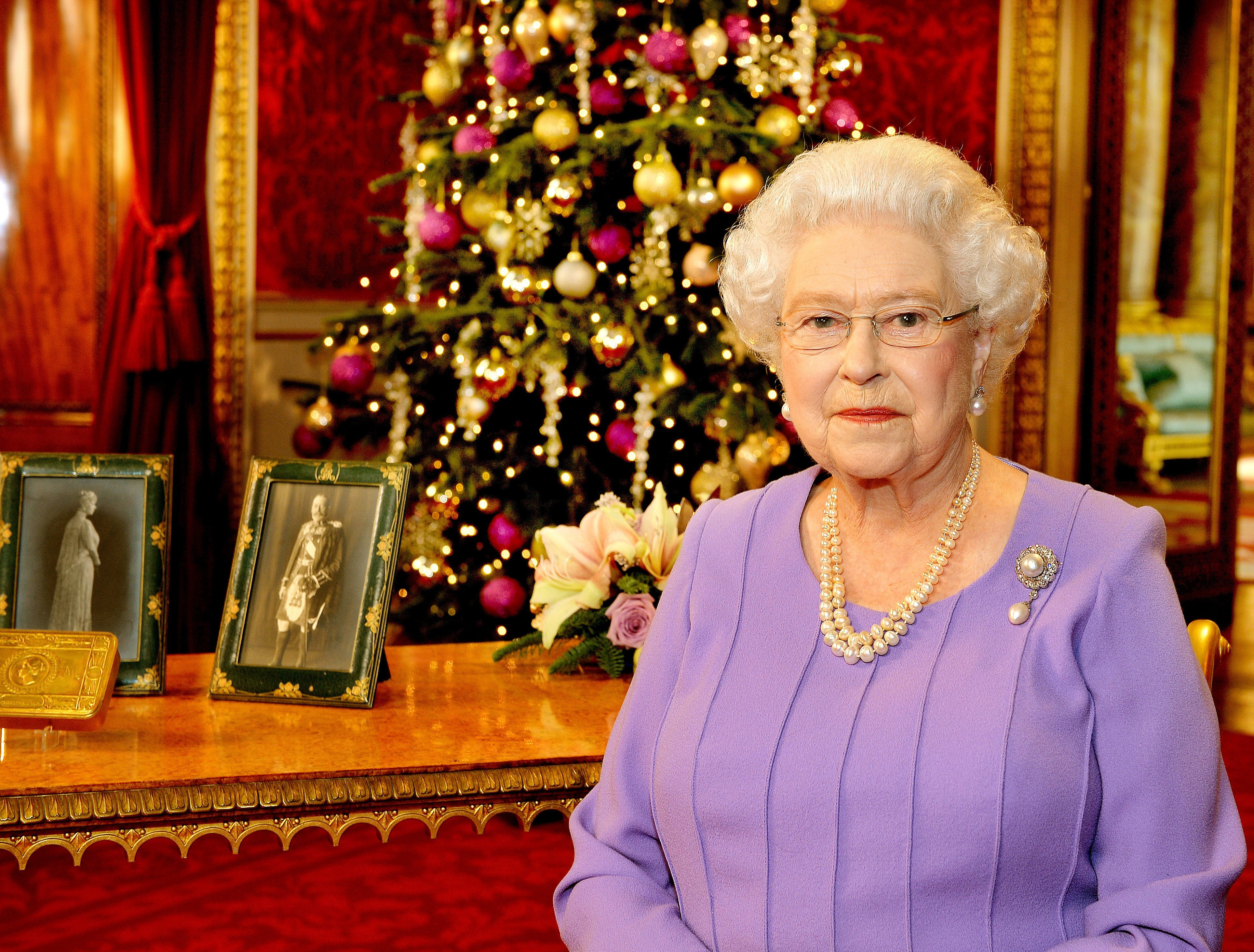 Queen Elizabeth II poses in the State Dining Room of Buckingham Palace after recording her Christmas Day television broadcast to the Commonwealth on December 10, 2014, in London. | Source: Getty Images.