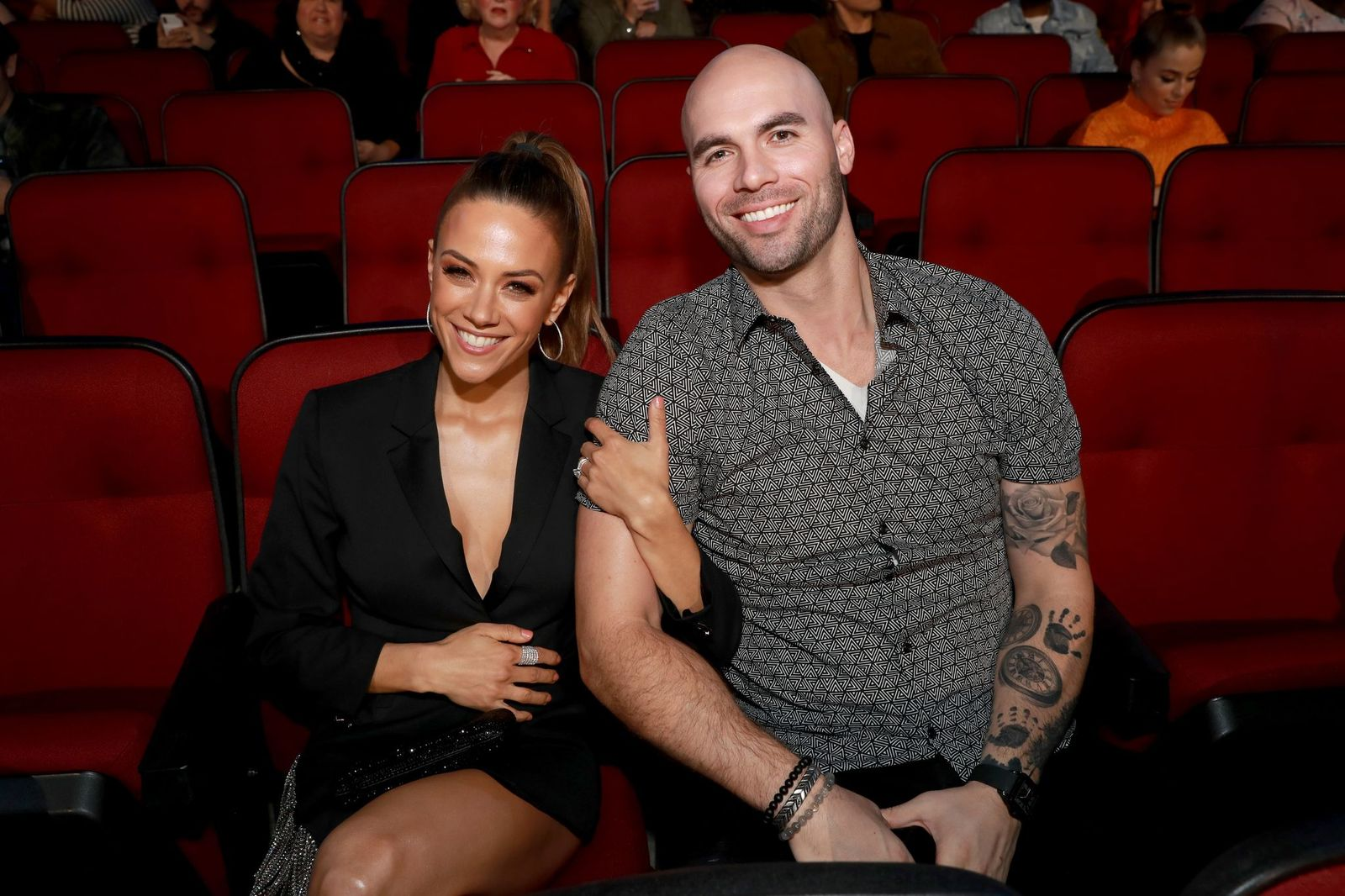 Jana Kramer and Mike Caussin attend the 2019 iHeartRadio Music Awards on March 14, 2019. | Getty Images