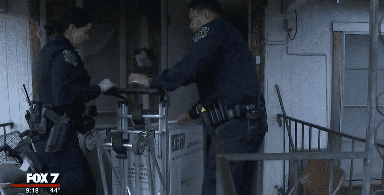 Officers Chasity Salazar and Bino Cadenas delivering the heating unit   Photo: Fox 7 Austin