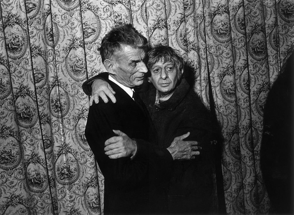 Playwright Samuel Beckett (1906 - 1989) embracing actor Jack MacGowran at a first night performance | Getty Images