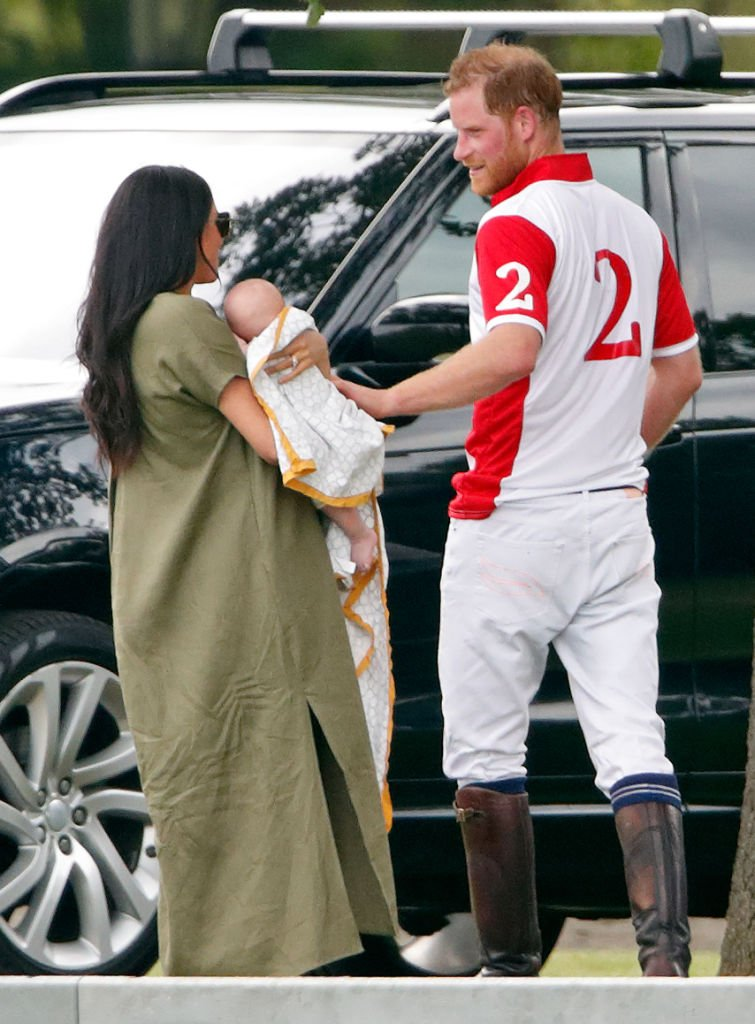 Meghan Markle holds son Archie next to husband Prince Harry while attending the King Power Royal Charity Polo Match in Wokingham, England on July 10, 2019 | Photo: Getty Images