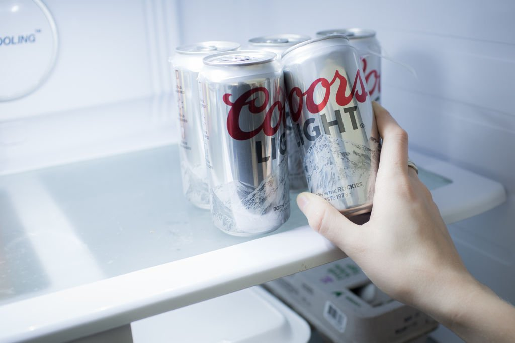 Cans of Molson Coors Brewing Co. Coors Light brand beer are arranged for a photograph in Madison, Connecticut, U.S., on Saturday, April 28, 2018. | Photo: Getty Images