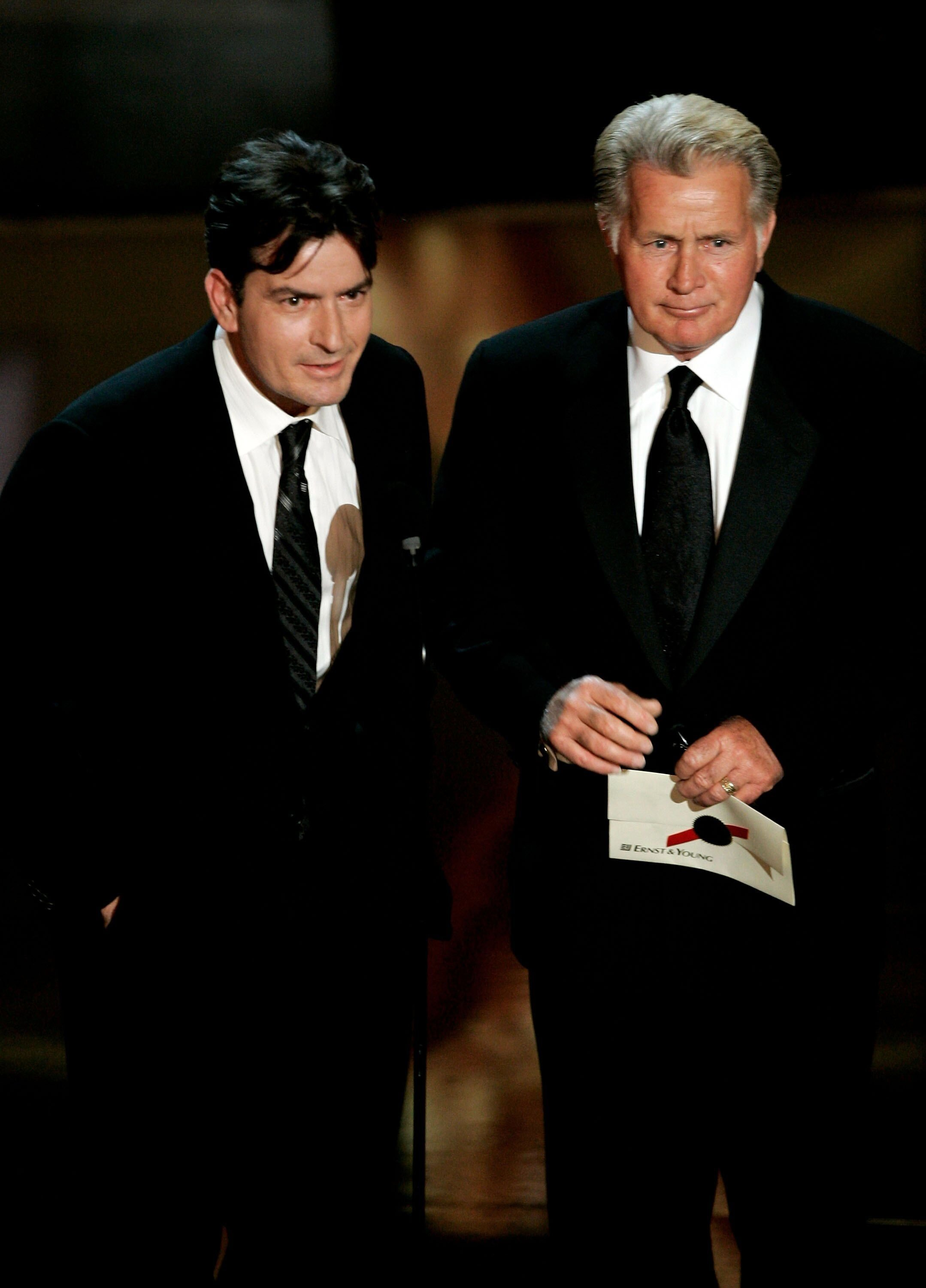 Charlie Sheen and Martin Sheen present the award for Outstanding Supporting Actress in a Drama Series onstage at the 58th Annual Primetime Emmy Awards. | Source: Getty Images