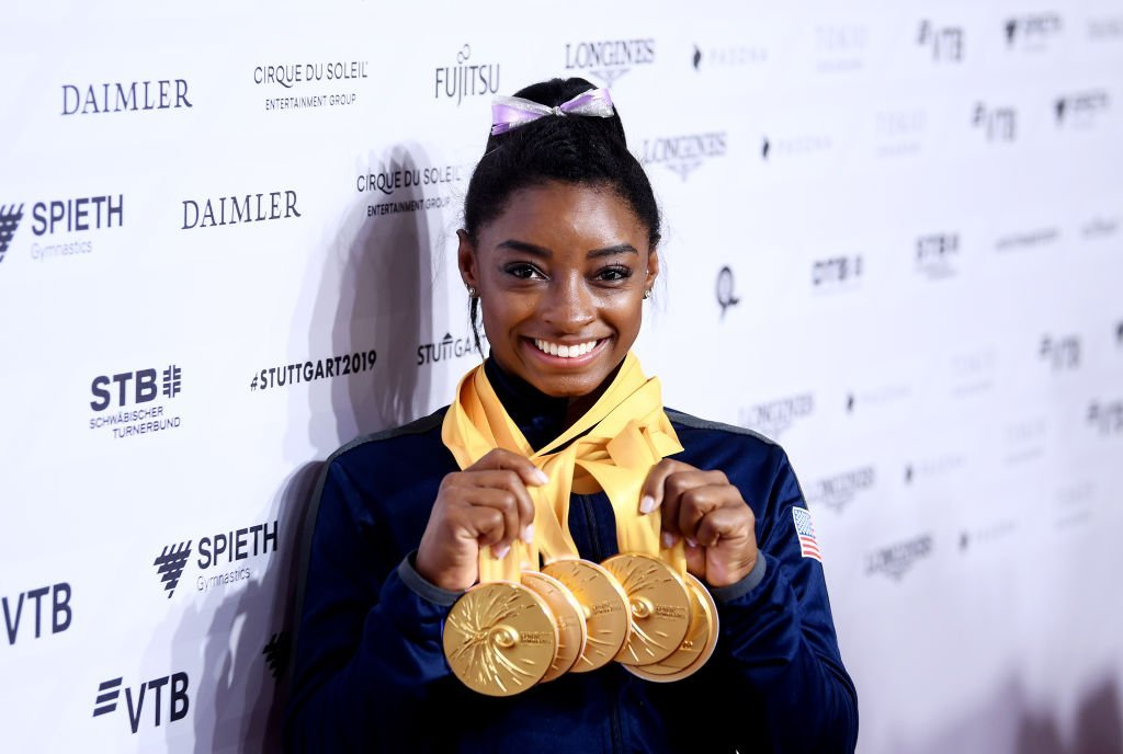 Simone Biles of The United States poses for photos with her multiple gold medals during day 10 of the 49th FIG Artistic Gymnastics World Championships at Hanns-Martin-Schleyer-Halle in Stuttgart, Germany | Photo: Getty Images