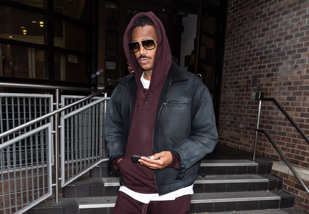 Marlon Wayans holds a cell phone in his hand as he leaves 'Good Day' at FOX 29 Studios on November 22, 2019, in Philadelphia, Pennsylvania | Source: Getty Images: (Photo by Gilbert Carrasquillo/GC Images)