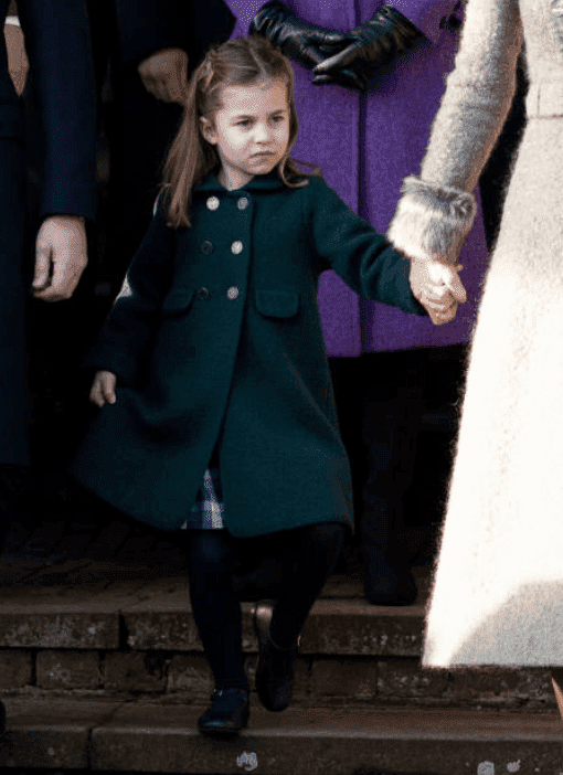 Princess Charlotte holds her mother, Kate Middleton's hand as she dips into a curtsy for Queen Elizabeth at the Christmas Day Church service at Church of St Mary Magdalene on the Sandringham estate, on December 25, 2019 in King's Lynn, England | Source: Mark Cuthbert/UK Press via Getty Images