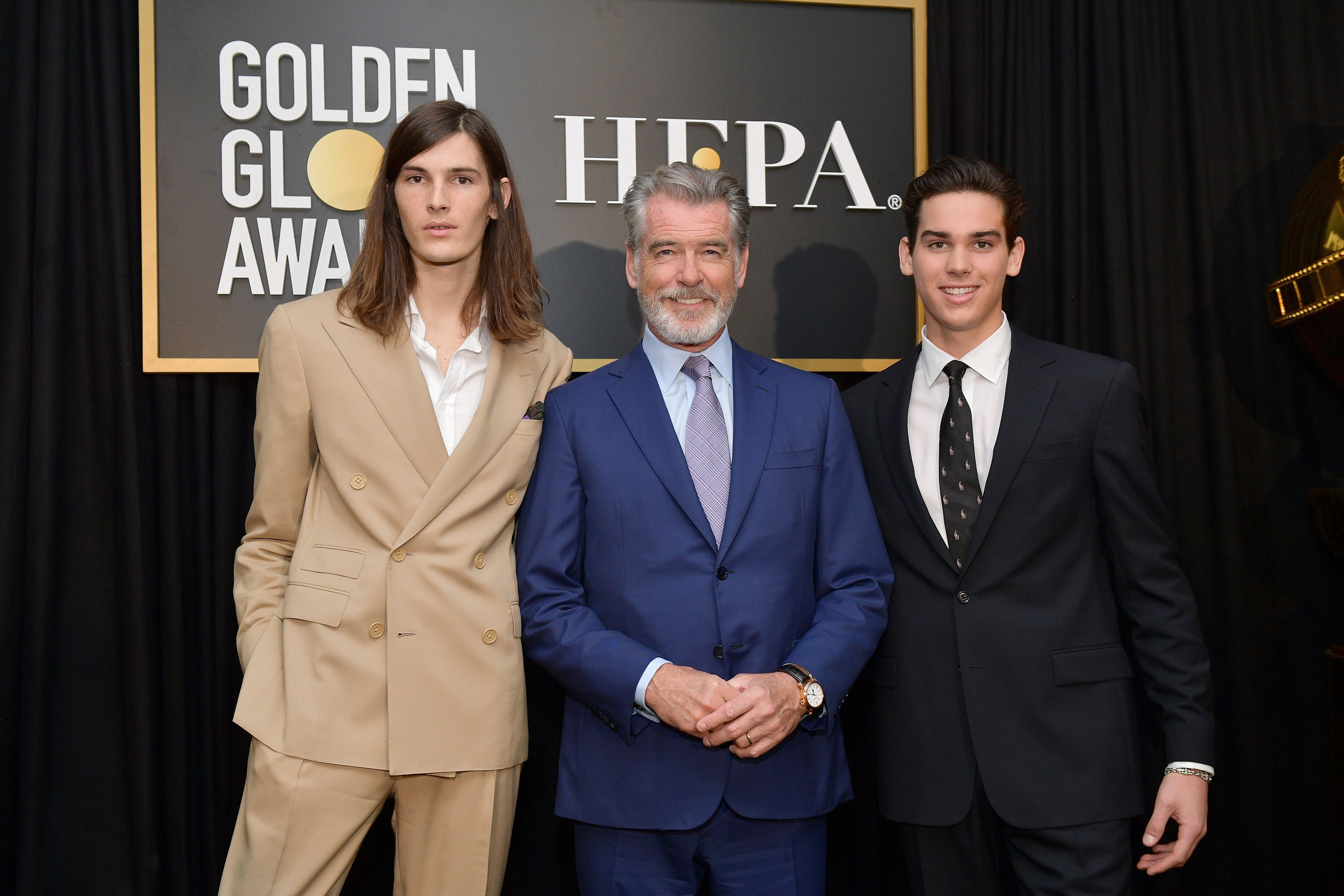Pierce Brosnan (C) poses with Golden Globe Ambassadors Dylan Brosnan (L) and Paris Brosnan onstage during the Hollywood Foreign Press Association and The Hollywood Reporter Celebration of the 2020 Golden Globe Awards Season. | Source: Getty Images.