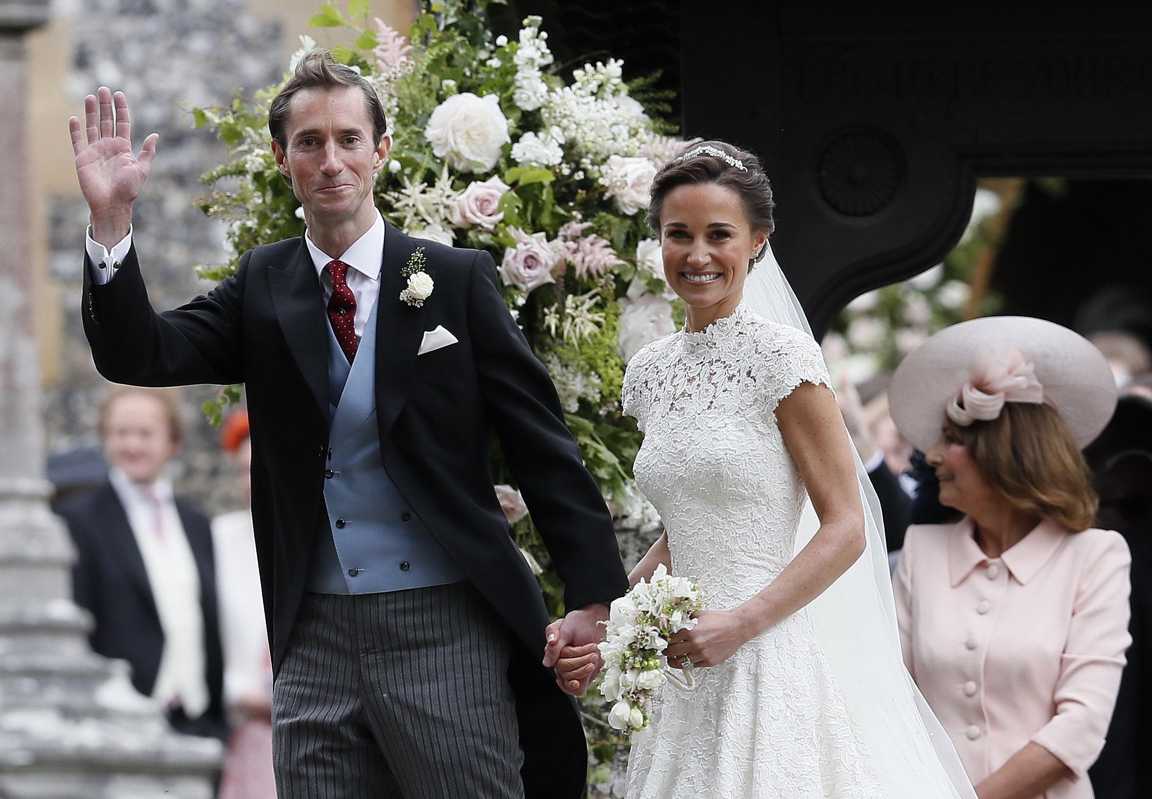 Pippa Middleton and James Matthews smile for the cameras after their wedding at St Mark's Church | Source: Getty Images