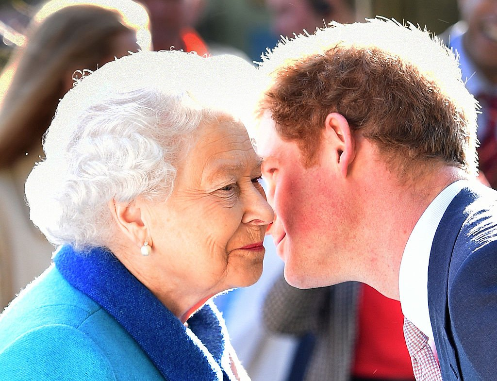 Queen Elizabeth II and Prince Harry attend the annual Chelsea Flower show at Royal Hospital Chelsea on May 18, 2015 in London, England | Photo: Getty Images