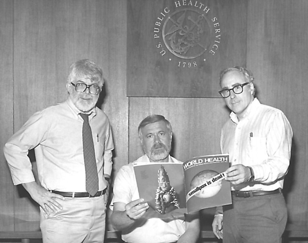 Three former directors of the Global Smallpox Eradication Program, Dr J. Donald Millar, Dr William H. Foege and Dr J. Michael Lane, holding world Health magazine, 1980. Image courtesy Centers for Disease Control (CDC)   Source: Getty Images