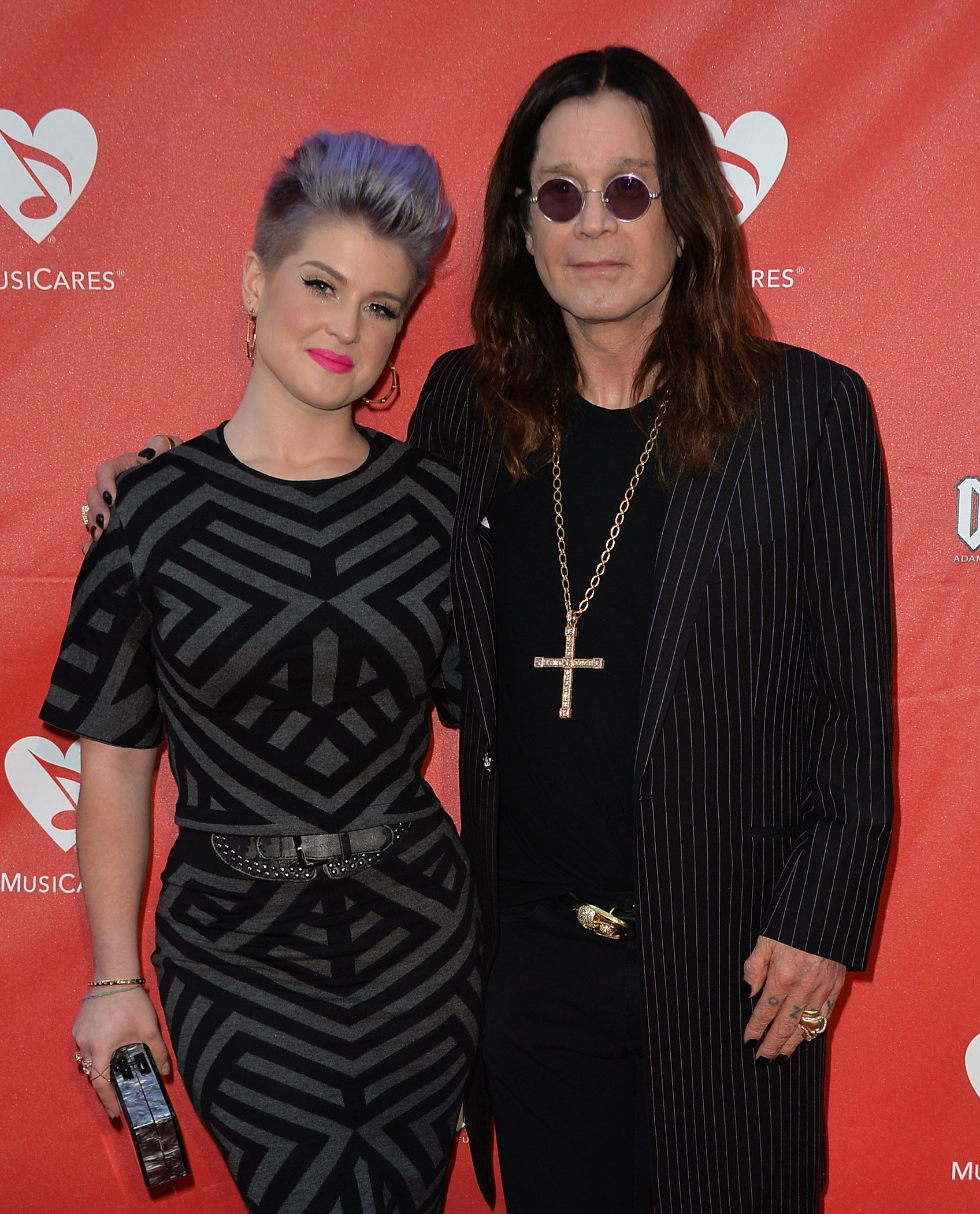 Kelly Osbourne with father Ozzy Osbourne during the 2014 Annual MusiCares MAP Fund Benefit Concert in Los Angeles California. | Photo: Getty Images