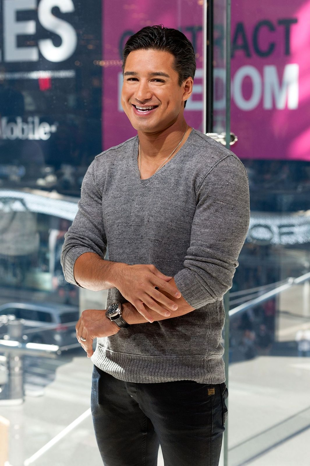 """Mario Lopez hosts """"Extra"""" at their New York studios in Times Square on October 6, 2014, in New York City 