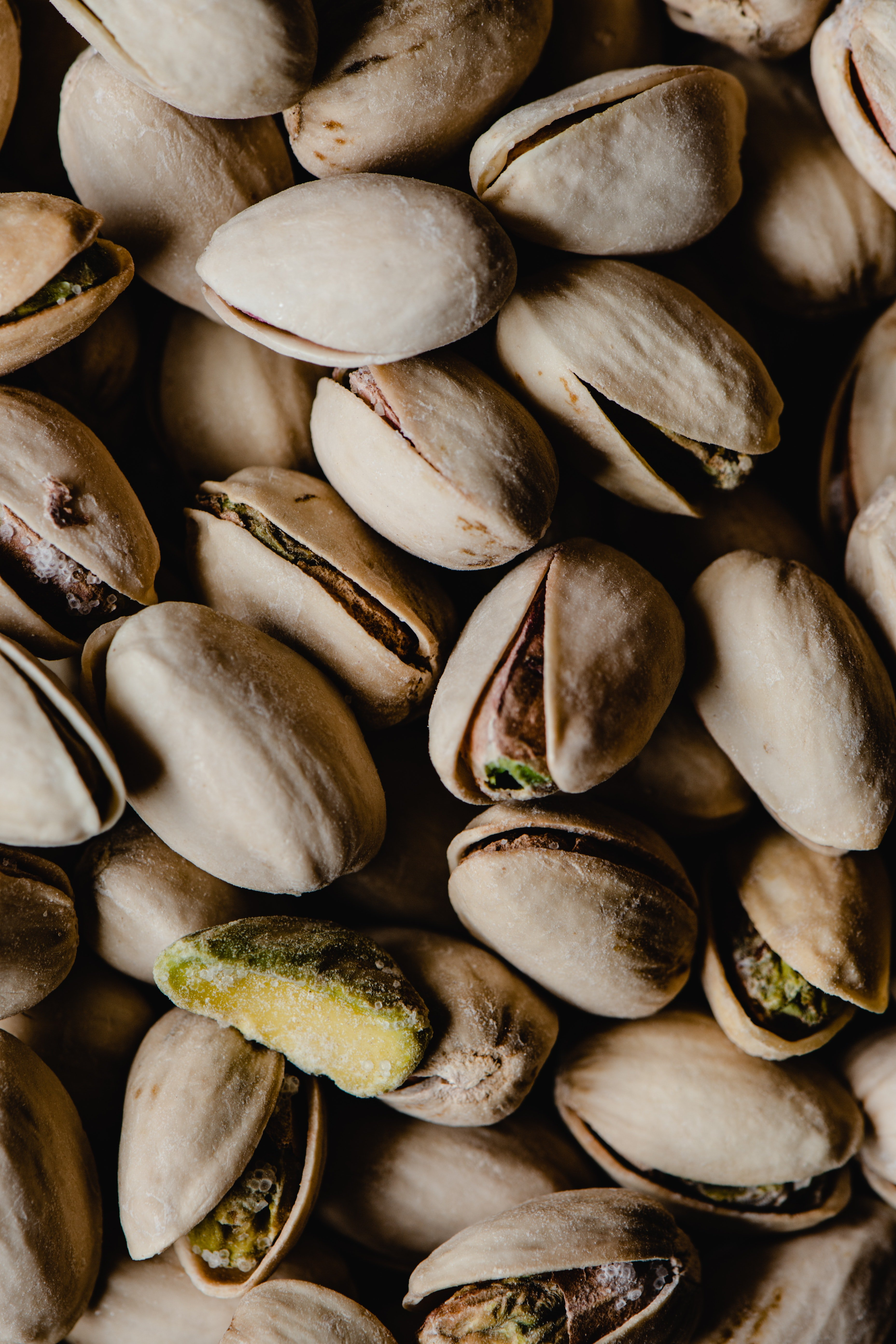 Pictured - A photograph of brown Pistachios | Source: Pexels