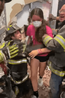 Giavanna Diesso being lifted out of the changing room by firefighter.   Photo: Facebook/Port Jefferson Fire Department