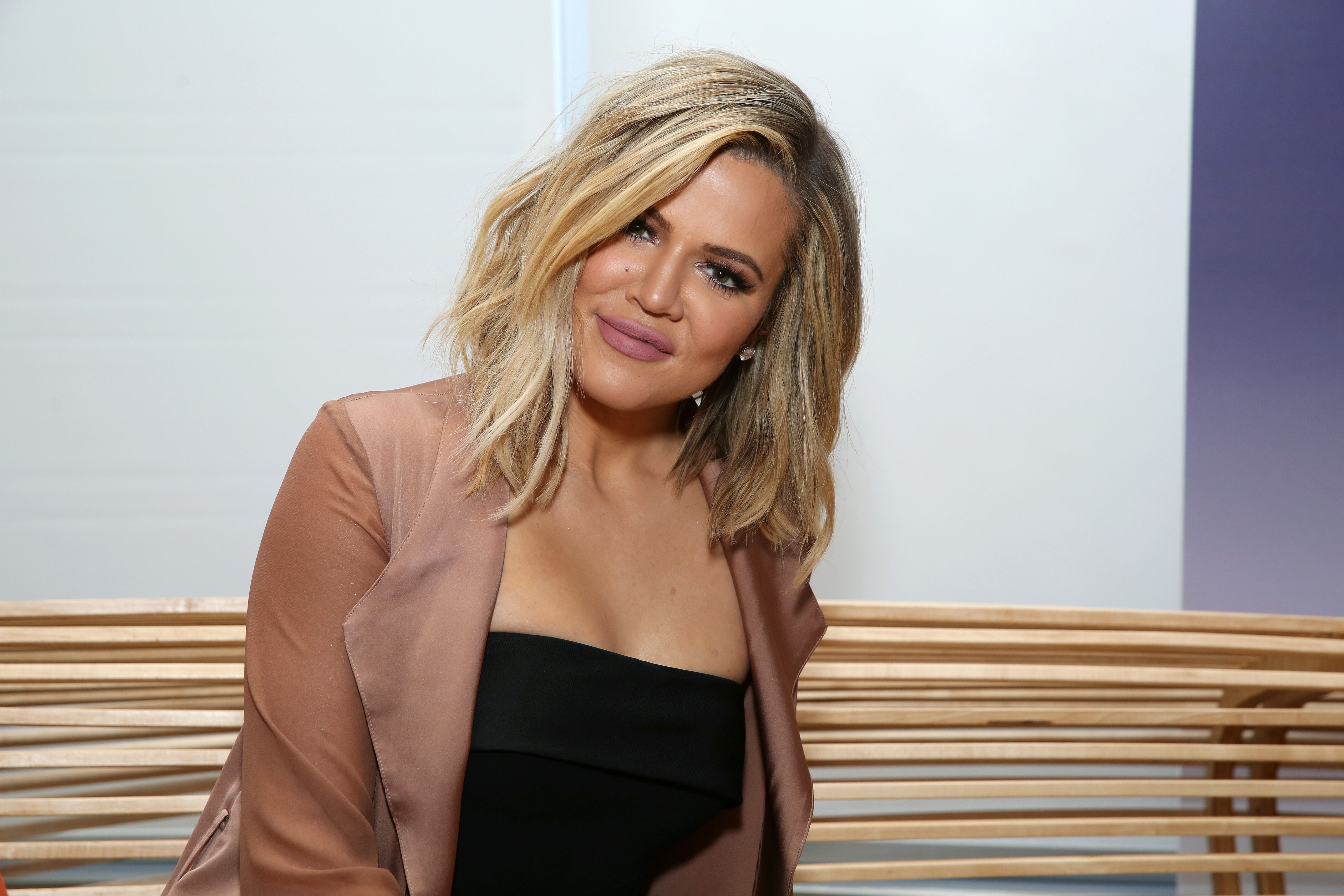Khloe Kardashian smiling for the camera at one of her guest appearances | Source: Getty Images/GlobalImagesUkraine