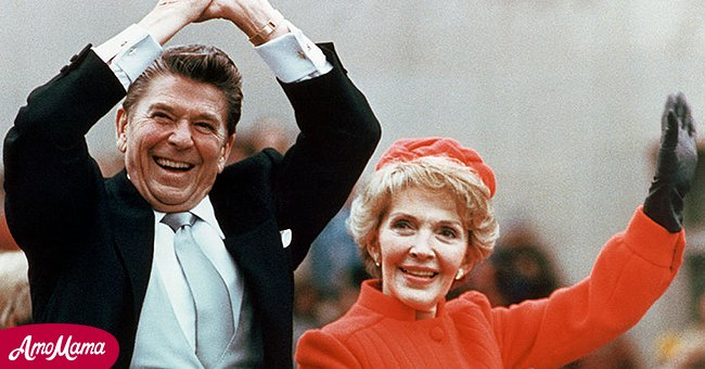 Ronald and Nancy Reagan waving and clasping hands in victory at Reagan's first inauguration, January 20, 1981. | Source: Getty Images