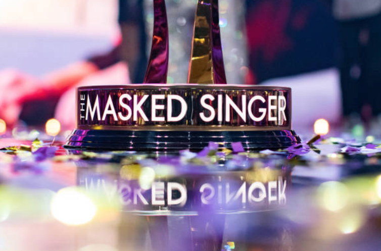 "The trophy for the champion at the end of very season for the Fox network show ""The Masked Singer"" displayed on a stage 